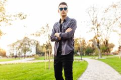 Attractive man dressed in stylish clothes, sunglasses, walks in stock photos