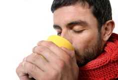 Attractive man drinking cup of coffee tea in winter warming his hands Stock Photography