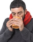 Attractive man drinking cup of coffee tea in winter warming his hands Stock Photo