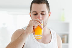 Attractive man drinking orange juice Stock Photo