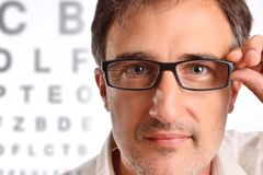 Attractive man with eye corrective glasses in consultation. Horizontal composition stock image