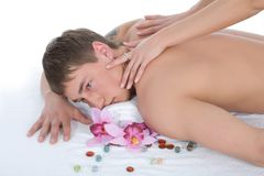 Attractive man getting spa treatment on white Stock Photo
