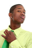 Attractive Man In Green Adjusting Necktie Stock Photography
