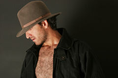 Attractive man in hat. Attractive man with hat and trenchcoat Royalty Free Stock Photo