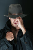 Attractive man in hat. Attractive man with hat and trenchcoat Stock Photography
