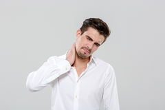 Attractive man have a neck pain. Attractive handsome young man have a neck pain Stock Images