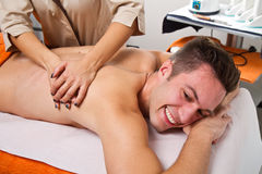 Attractive man having a back massage Stock Photo