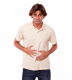 Attractive man having a pain in his stomach Royalty Free Stock Photos
