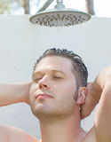 Attractive man having shower Royalty Free Stock Image