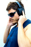 Attractive man with headphones Stock Photos