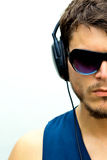 Attractive man with headphones stock photography
