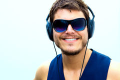 Attractive man with headphones Stock Photo