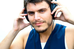Attractive man with headphones Stock Images
