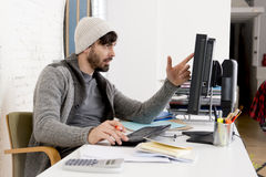 Attractive man hipste trendy businessman working desktop computer at home office Royalty Free Stock Photography