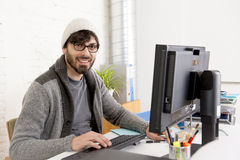 Attractive man hipster trendy style businessman working home office with desktop computer Royalty Free Stock Photo