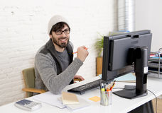 Attractive man hipster trendy style businessman working home office with desktop computer Stock Photography