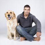 Attractive man and his pet Royalty Free Stock Images