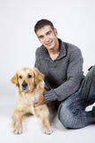 Attractive man and his pet Stock Image