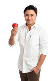 Attractive man holding apple wearing a white shirt Stock Image