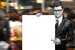 Attractive Man Holding Blank White Sign. Double exposure of Business man handing a blank business card with clipping path Royalty Free Stock Photo