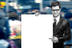 Attractive Man Holding Blank White Sign. Double exposure of Business man handing a blank business card with clipping path stock photos