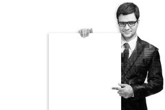 Attractive Man Holding Blank White Sign. Double exposure of Business man handing a blank business card isolated with clipping path Royalty Free Stock Photo