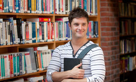 Attractive man holding a book Stock Image