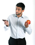 Attractive man holding Chocolate and Apple Stock Photo