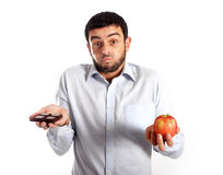 Attractive man holding Chocolate and Apple Royalty Free Stock Photography
