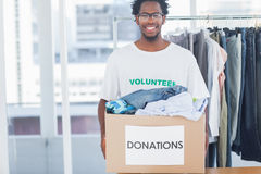 Attractive man holding a donation box Stock Photos