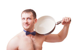Attractive man holding a frying pan Royalty Free Stock Images