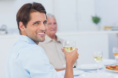 Attractive man holding a glass of white wine Stock Photography