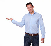 Attractive man holding his right palm Stock Images