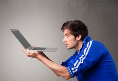 Attractive man holding modern notebook Royalty Free Stock Image