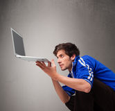 Attractive man holding modern notebook Stock Photo
