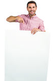 Attractive man holding and pointing white sheet Stock Photo