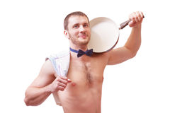 Attractive man holding a towel and frying pan Royalty Free Stock Photo