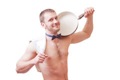 Attractive man holding a towel and frying pan Stock Photos