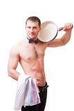 Attractive man holding a towel and frying pan Stock Photo