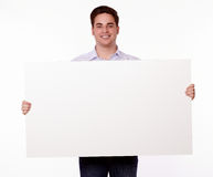 Attractive man holding up a placard Royalty Free Stock Image