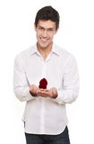 Attractive  man holds a gift box holds jewelery Royalty Free Stock Images