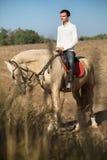Attractive man on horseback Stock Photo