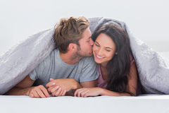 Attractive man kissing his wife Royalty Free Stock Photos