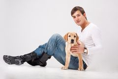 Attractive man with Labrador Stock Images