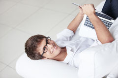 Attractive man with laptop Stock Image