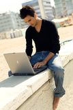 Attractive man with laptop Stock Photo
