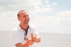 Attractive man laughing. Against blue sky Royalty Free Stock Image