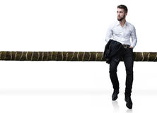 Attractive man leaning on a trunk. Attractive man with beard leaning on a trunk Stock Photo