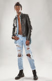 Attractive Man in Leather Jacket and Ripped Jeans Royalty Free Stock Photography