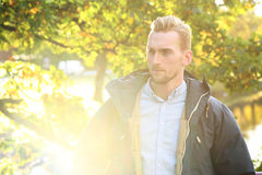 Attractive man with lens flare Stock Images